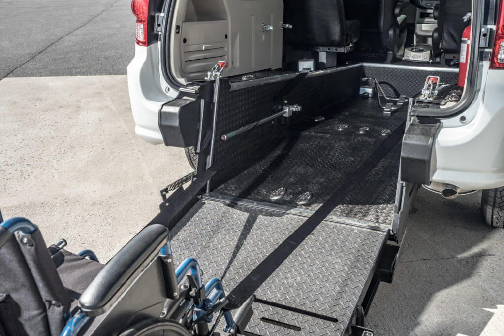 Rear entry wheelchair accessible conversion mini van ramp